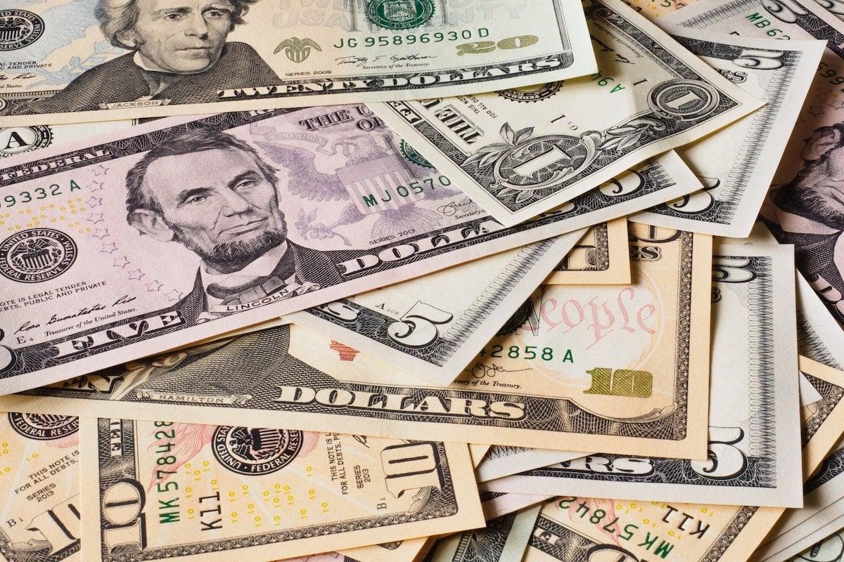 Pile of paper money including ones, fives, tens & twenties