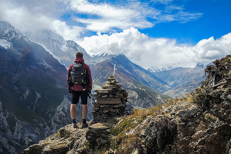 How-to-Manage-Employees-Paid-Time-Off-RealHR-Solutions-Hiking-Mountains