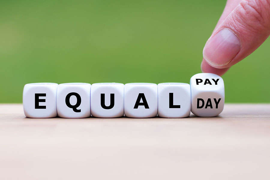 """Symbol for the equal pay day. Dice form the expression """"EQUAL PAY DAY""""."""